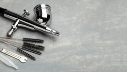 Airbrush cleaning. Brushes and other airbrush cleaning tools. Copy space for text