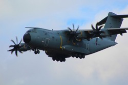 Airbus A400 Atlas military transport plane flying low with wheels down