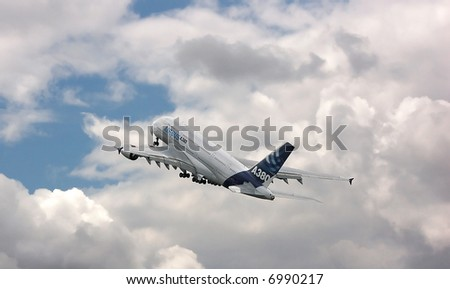 Airbus A380 flying into the clouds