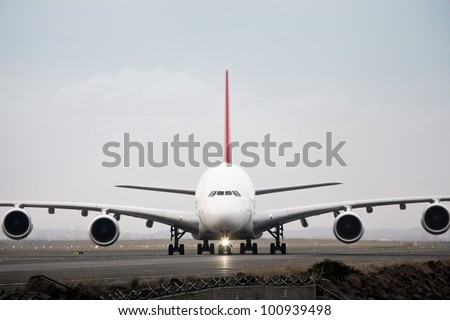Airbus A380 jet airliner on runway - front view