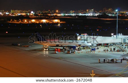 Airbus A-320 jet at airport during the night