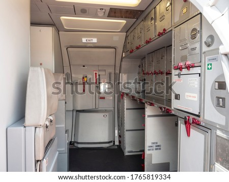 Aircraft aft galley with full of storage unit. The most right unit show how it look like.  Stockfoto ©