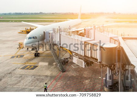 Aircraft being being maintenance at gate terminal., Business transportation and service. #709758829
