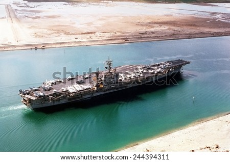Aircraft carrier JOHN F. KENNEDY in the Suez Canal traveling home to Norfolk Virginia after a seven month deployment during the First Iraq War. 1991. Mar. 1 1991.