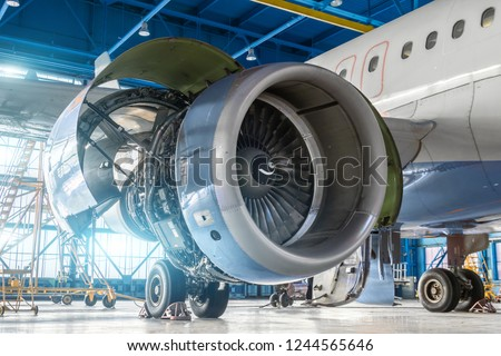 Aircraft engine jet on the wing during maintenance in the hangar