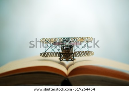 aircraft fighter on open education book with abstract light , education planner concept. #519264454