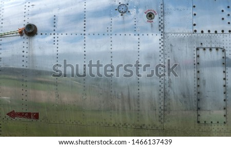 Old metal surface of the aircraft fuselage with rivets