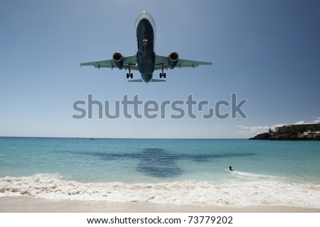 Aircraft in blur motion is landing at Princess Juliana International Airport in Netherlands Antilles. April 2010.