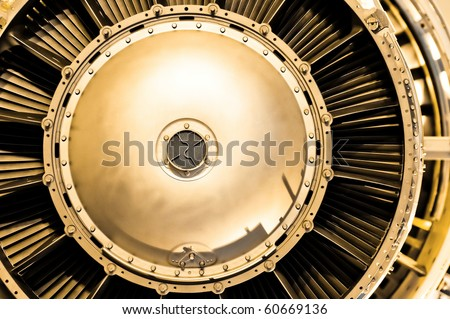 aircraft jet engine abstract with a golden tint