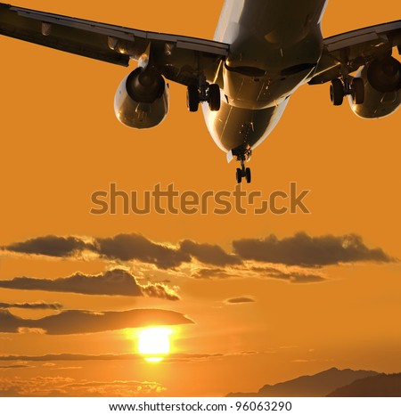 Aircraft landing in full sunset