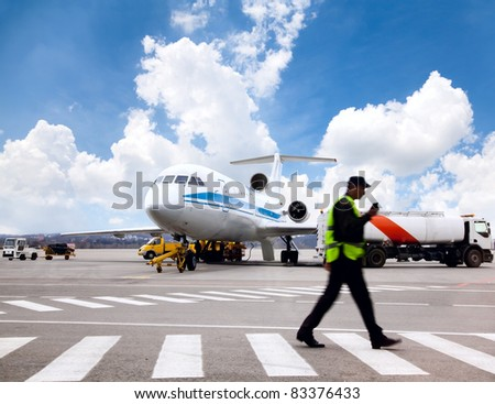 Aircraft maintenance people during refueling