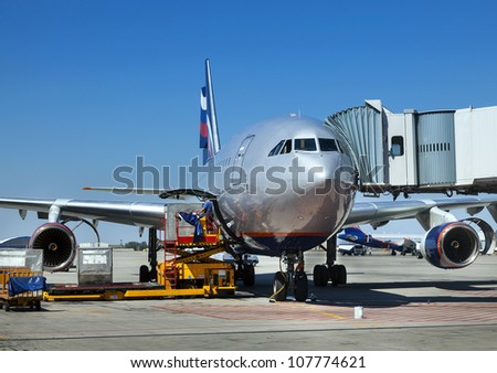Aircraft maintenance people during refueling and loading baggage in aircraft