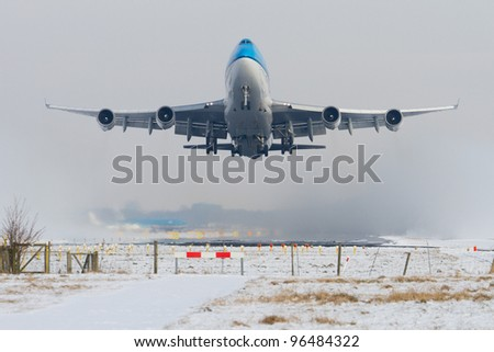 Aircraft taking off in snowy conditions