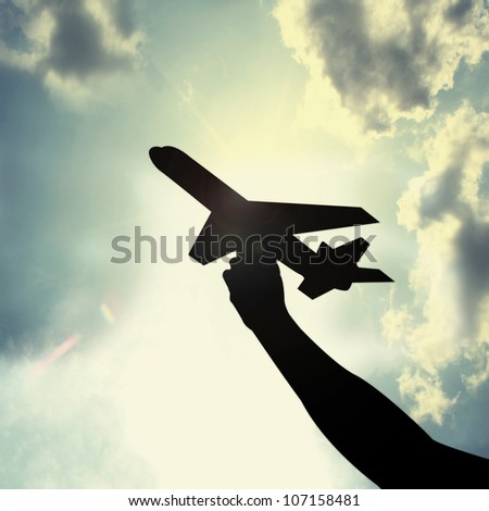 aircraft toy  in hand - stock photo