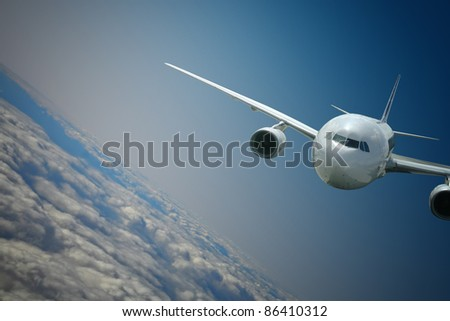Aircraft turning above the clouds