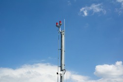 Aircraft warning light - light on the top of high an tall pole, post and mast. Blue sky as copy space.