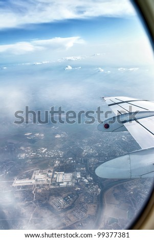 aircraft wing during flight  with a nice blue sky and landscape