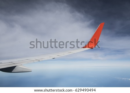 Aircraft Wing in the blue sky #629490494