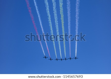 aircrafts aerobatic group drawing Spanish flag figure in the sky