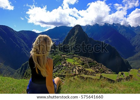Aireal view on ancient city Machu Picchu, Peru, South America. Tourist enjoy the view