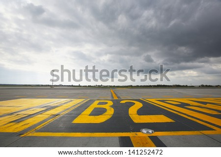 Airfield - marking on taxiway is heading to runway.