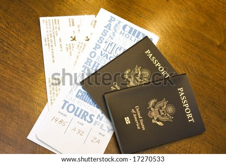 Airline boarding passes in a travel envelope with two new passports
