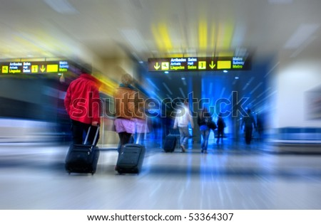 Airline passengers walking in the airport terminal