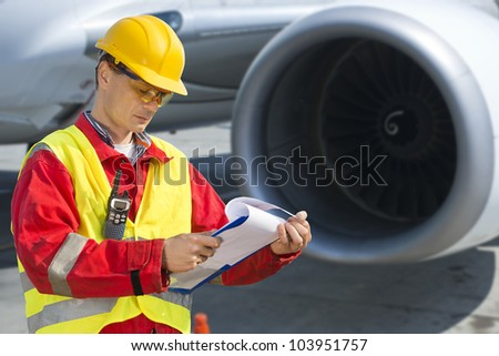 Airline safety engineer going through a pre-flight checklist