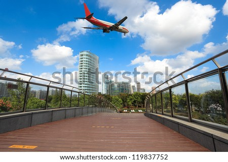 airliner and footbridge with modern building in shanghai north bund