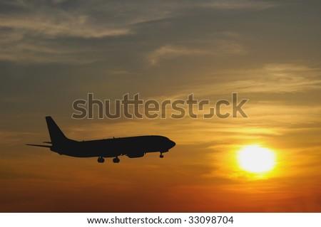airliner landing at sunset, closeup