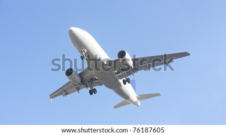 airliner makes its landing approach to oporto airport