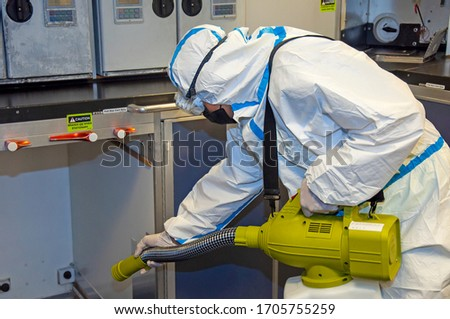 Airlines galley cleaning for Coronavirus Covid-19. Airplane cabin deep cleaning. Stockfoto ©