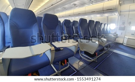 Airlines Seat. Blue seats in the cabin of the plane  #1553491274