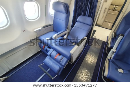 Airlines Seat. Blue seats in the cabin of the plane  #1553491277