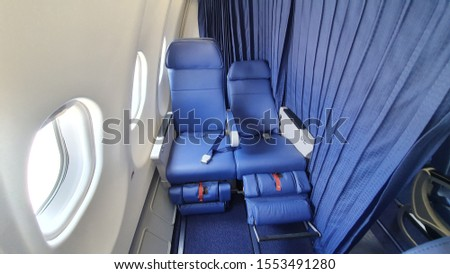 Airlines Seat. Blue seats in the cabin of the plane  #1553491280