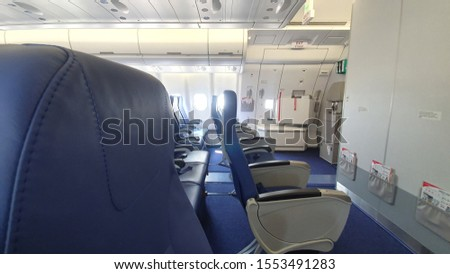 Airlines Seat. Blue seats in the cabin of the plane  #1553491283