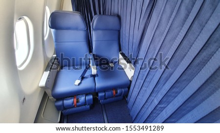 Airlines Seat. Blue seats in the cabin of the plane  #1553491289