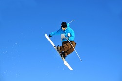 Airoski: a skier performing a turn in mid jump