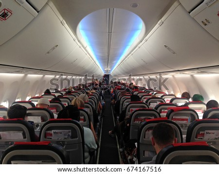 Airplane aircraft plane cabin seats from back stock, photo, photograph, picture, image