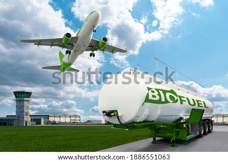 Airplane and biofuel tank trailer on the background of airport. New energy sources Сток-фото ©