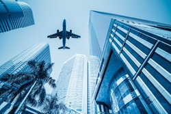 airplane and business buildings ,viewed from below