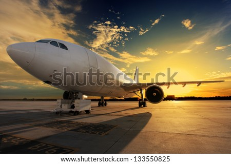 Airplane at sunset - back lit stock photo