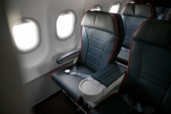 Airplane cabin seats with passengers. Economy class of new cheapest low-cost airlines without delay or cancellation of flight.