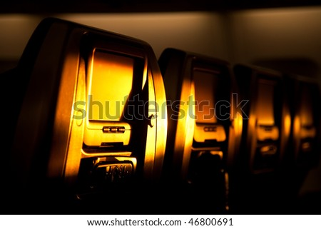 Airplane chairs lighted by sunset