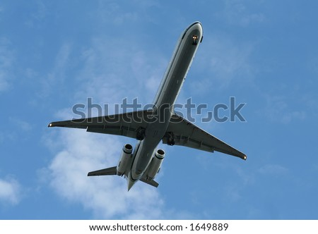 Airplane coming down with its landing gear out