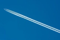 Airplane Contrails in Blue Sky for use as a background