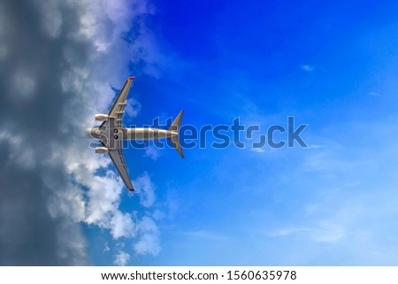 Airplane entering the clouds. Airplanes enter the cloud, every in own way. Writing area #1560635978