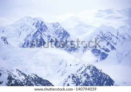 Airplane flies in St. Elias National Park and Preserve, Wrangell Mountains, Wrangell, Alaska