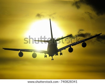 Airplane flies into the sunset - Shutterstock ID 740828341