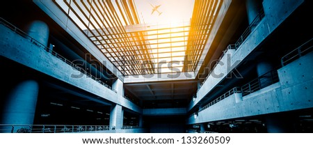 airplane fly above the airport building at shanghai china. #133260509